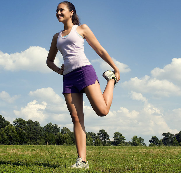 Woman stretching before doing exercise
